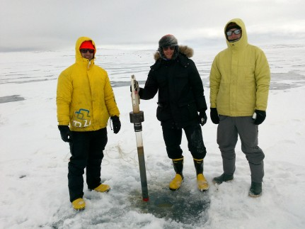 Matthew Gillman, Benjamin Amann, and Casey Beel with a recovered sediment core