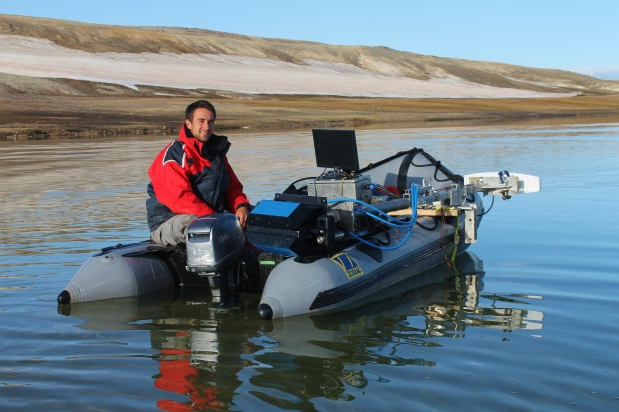 Matthew Gillman, in the zodiac performing sidescan sonar and acoustic surveys